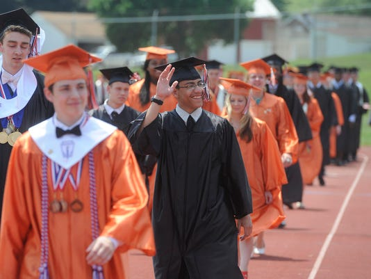 Northeastern High School seniors wave to the crowd as they walk into the stadium during the graduation ceremony held  on Saturday, May 30, 2015.   Jason Plotkin - Daily Record/Sunday New