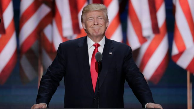 President Donald J. Trump smiles as he takes the stage during the final day of the Republican National Convention in July 2016.