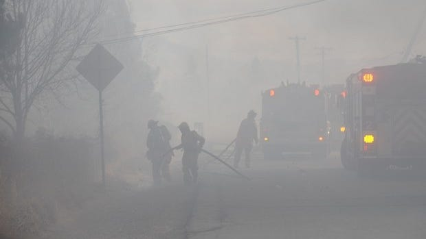 Firefighters work the Washoe Drive Fire Jan. 19, 2012, in Pleasant Valley.