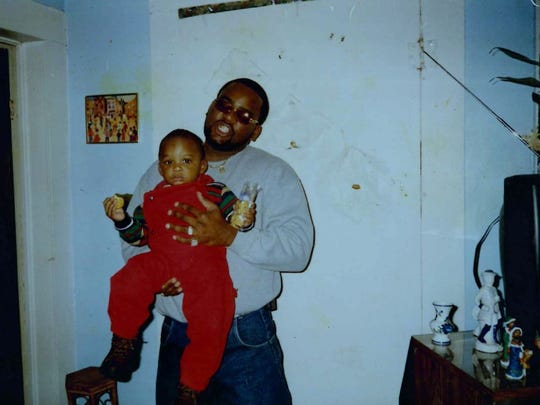 Michael Eddings, pictured here with his son, died amid