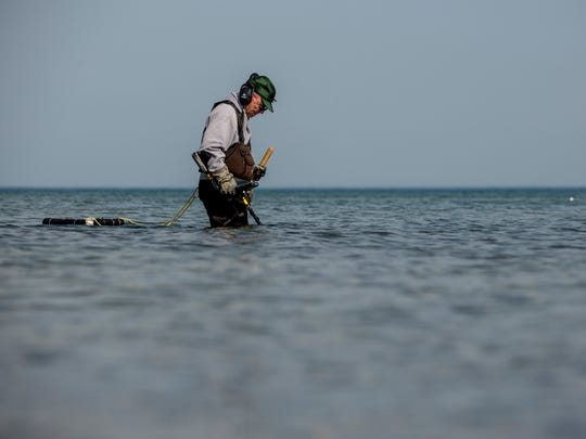 John Klause, of Emmett Township, uses a metal detector