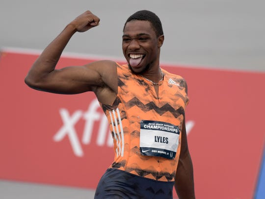 Noah Lyles dances after defeating Ronnie Baker (not pictured) to win the 100m, 9.88 to 9.90, during the USA Championships at Drake Stadium.