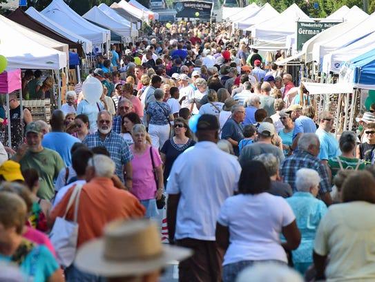 Crowds enjoy ChambersFest Old Market Day street festival