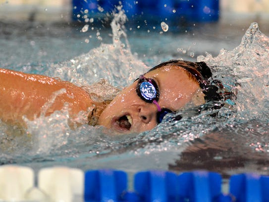 Sophie Barnes of Dover dominates the 200 free event