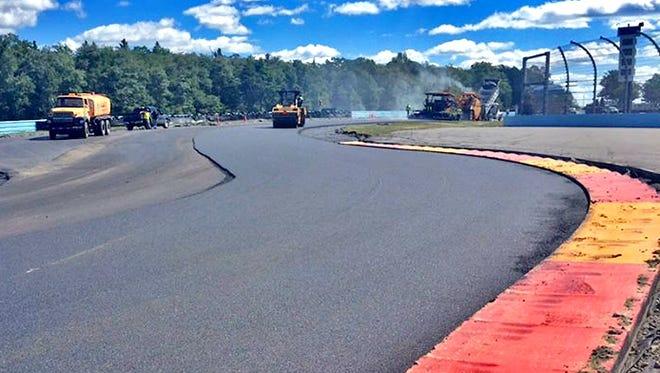 Workers lay down a layer of asphalt in the Inner Loop earlier this week at Watkins Glen International.