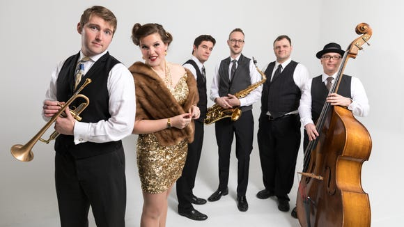 "Carey Rayburn (left) is a Klahowya Secondary School graduate who heads up ""electro swing"" sextet Good Co."