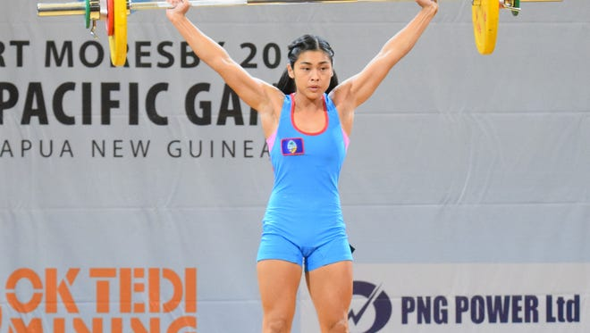 In this file photo, Kimberly Taguacta lifts a 57-kilogram snatch at the 2015 Pacific Games. Taguacta will represent Guam at the 2015 International Weightlifting Federation World Championships on Nov. 21.