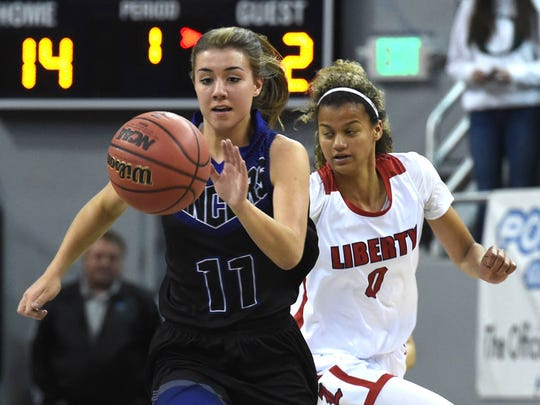 McQueen's Kaila Spevak chases down a loose ball against Liberty's Rae Burrell, back, during the girls semifinal game at the 2018 NIAA 4A State Basketball Championships at Lawlor Events Center on Feb. 22, 2018.