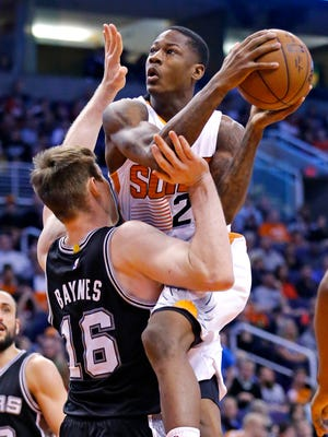 Phoenix Suns guard Archie Goodwin (20) shoots against San Antonio Spurs center Aron Baynes (16) during the second half of their NBA game Saturday, Feb. 28, 2015 in Phoenix.