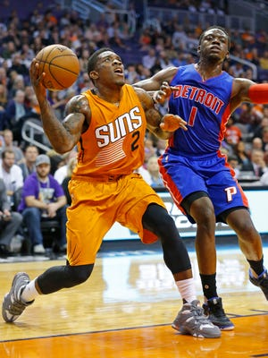Phoenix Suns guard Eric Bledsoe (2) works against Detroit Pistons guard Reggie Jackson (1)  in the first half of their NBA game on Friday, Nov. 6, 2015, in Phoenix.