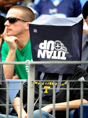A fan watches the game with a bag over their head as the Titans fall farther behind to the Texans.