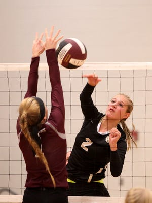 Buffalo Gap's Abby Flint hits over the net to Stuarts Draft's Deborah Black at Tuesday night's volleyball match on Sept. 20, 2016.