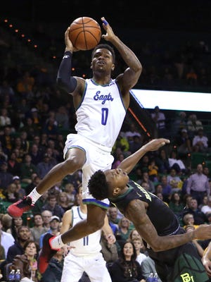 Florida Gulf Coast guard Brandon Goodwin (0) is fouled by Baylor guard Wendell Mitchell during an NCAA college basketball game, Friday, Nov. 18, 2016, in Waco, Texas. (Jerry Larson/Waco Tribune Herald via AP)