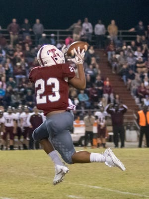 Shermari Jones (23) catches the pass and scores a touchdown during the Navarre vs Tate high school playoff game at Tate High School on Friday.
