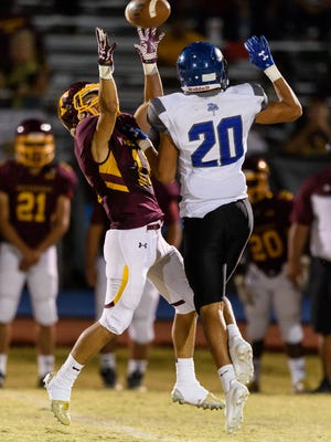 Tolleson's Rudy Valdez catches a 43 yard pass over Westview's Michael Lopez in the second quarter on Friday, Sept. 29, 2017, at Tolleson High School in Tolleson, Ariz.