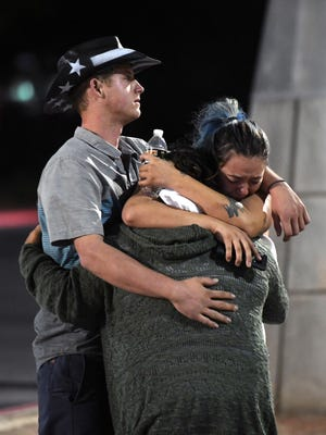 People hug and cry outside the Thomas & Mack Center.  People who could not go to hotel-casinos that were closed after the shooting are temporarily staying at the center.