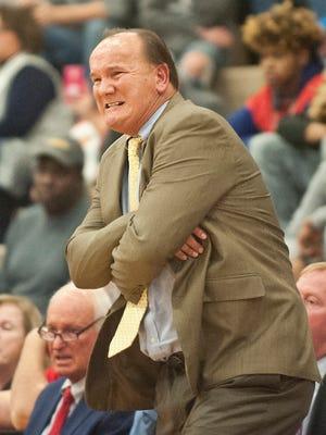 Scott County boys basketball coach Billy Hicks reacts to a play during a game at Ballard earlier this season.