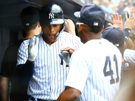 New York Yankees designated hitter Giancarlo Stanton (27) is congratulated after hitting a two run home run against the Kansas City Royals during the fifth inning during the first game of a doubleheader at Yankee Stadium.