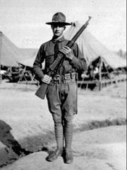 Sen. Strom Thurmond R-SC., holds a rifle in 1922 during