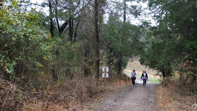 Cherie Hammond and Mitzi Greene walk up a steep trail at City of Brentwood's new 320-acre Smith Park,  which has 6 miles of hiking trails.