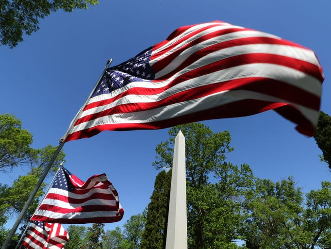 American flags lining an interior road at Pinelawn