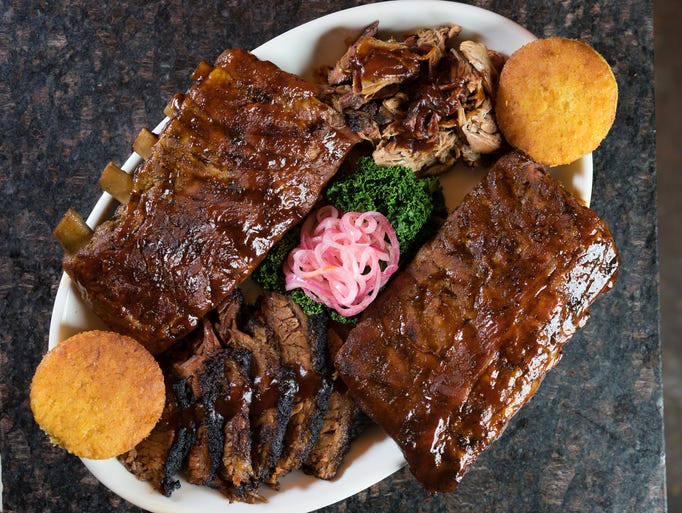 Smoked BBQ meats including ribs and brisket.