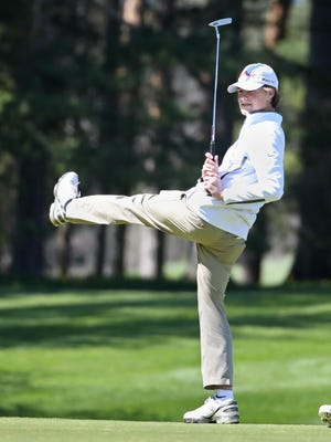 Pittsford Sutherland's Danny Gianniny tries a little high-kick to help his putt as it come up short on the first hole.