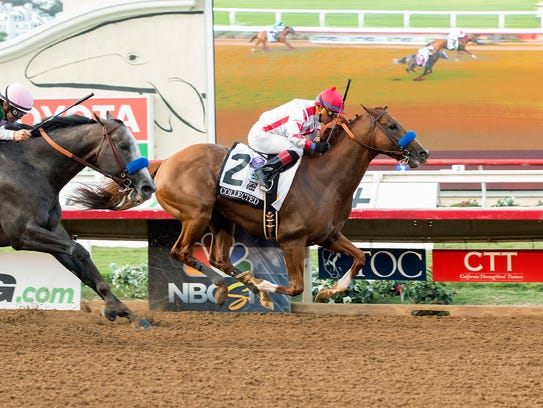 Collected, with jockey Martin Garcia up, right, outlegs