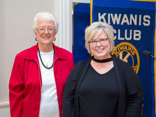 Nancy Miller (left) introduces Esther Cox as a new