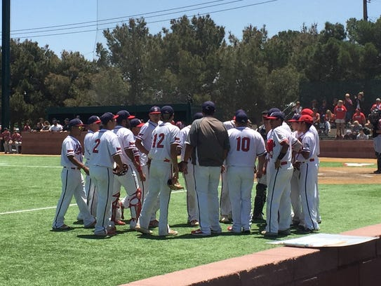 The Socorro baseball team huddles together prior to
