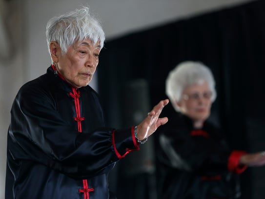 Terri Hamer and her group perform for the crowd during the annual Asian Bazaar, an Asian cultural festival hosted by the Association of Asian-American Women at the El Paseo de Santa Angela Saturday, Oct. 21, 2017.