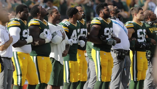 The Green Bay Packers are shown during the national anthem before their game against the Cincinnati Bengals  Sunday, September 24, 2017 at Lambeau Field in Green Bay, Wis. NFL players responded in full force Sunday after President Trump repeatedly called for swift punishment against those who chose to protest by not standing during the national anthem. Demonstrations spread throughout the league as many players broke out of their routine by joining the protests or engaging in team-wide displays of unity. Former San Francisco 49ers quarterback Colin Kaepernick began the protests last year by choosing not to stand during the anthem and remains a free agent, said he wanted to speak out against racial injustice and police brutality.   DAN POWERS/APPLETON POST-CRESCENT