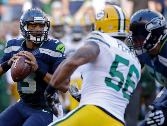 Seattle Seahawks quarterback Russell Wilson drops back