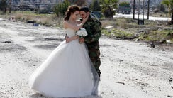 Newly-wed Syrian couple Nada Merhi,18, and Hassan Youssef,27,