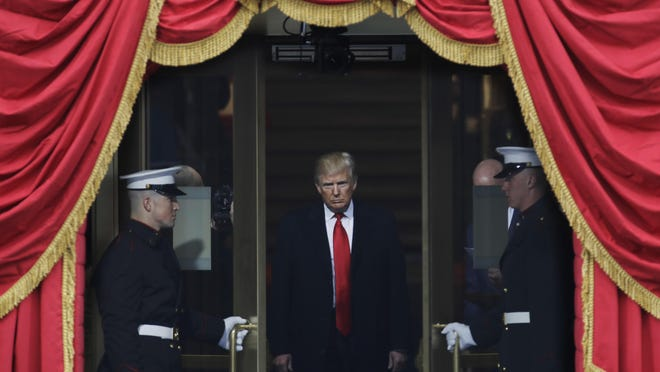 Then-President-elect Donald Trump steps out to the portico to be sworn in as 45th president of the United States during the 58th Presidential Inauguration at the U.S. Capitol in Washington.