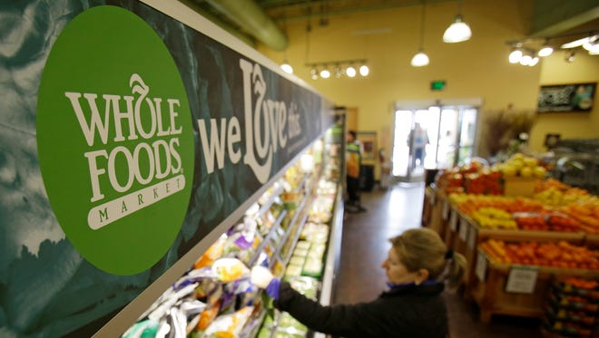 Whole Foods opens its first 365 store, a budget-friendly concept aimed at Millennials, May 25 in Los Angeles.