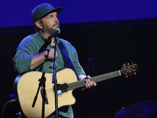 NASHVILLE, TN - SEPTEMBER 20:  Singer/Songwriter Garth Brooks performs during NSAI 50 Yearsof Songs at Ryman Auditorium on September 20, 2017 in Nashville, Tennessee.  (Photo by Rick Diamond/Getty Images)