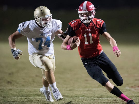 Greenville's Davis Beville (11) attempts to evade D.W.