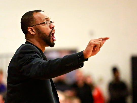 York High Head Coach Clovis Gallon directs his team