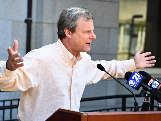 York City Mayor Michael Helfrich speaks as organizers