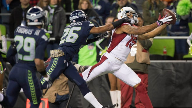 Nov. 15, 2015; Seattle; Cardinals receiver Michael Floyd catches a touchdown pass against Seahawks cornerback Cary Williams during the second quarter at CenturyLink Field.