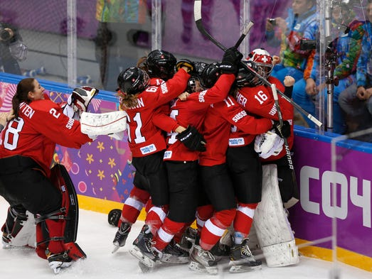 Team Switzerland celebrates defeating Sweden 4-3 in the women's ice hockey bronze medal game.