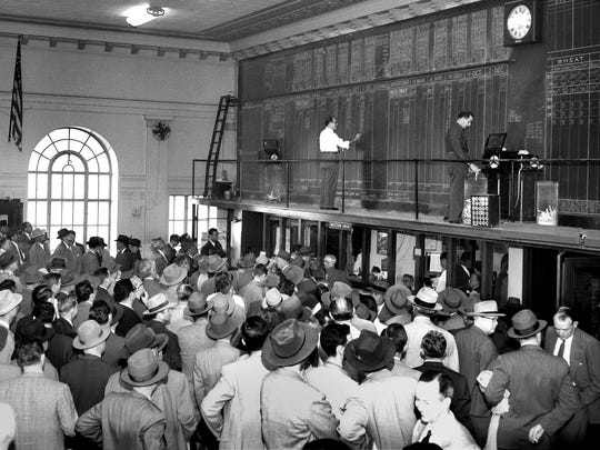 Cotton men jam the Memphis Cotton Exchange on March 8, 1951.