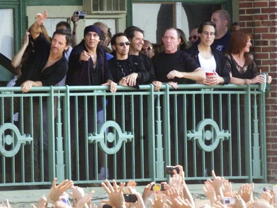 "Bruce Springsteen and the E Street Band wave to the crowd from Convention Hall during the NBC ""Today"" show broadcast live from Asbury Park Tuesday July 30, 2002."