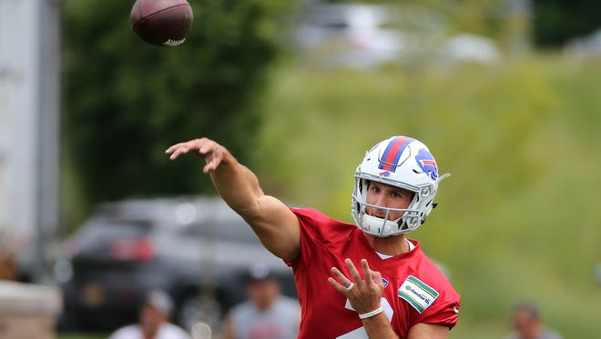 Bills rookie quarterback Nathan Peterman delivers a pass during training camp.