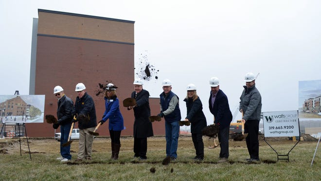 Local officials joined Watts Development Group leaders on Friday in the groundbreaking of a new two-building project on Coralville's Iowa River Landing.