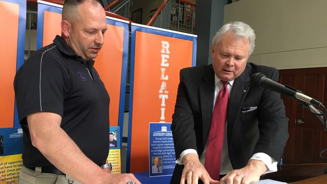 Marc Kelly, chief executive officer of University Academy of Central Louisiana, and Rick Brewer, president of Louisiana College in Pineville, on Tuesday sign a one-year dual enrollment agreement for UA students.