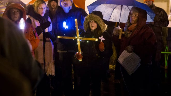 """Knightstown residents hold a """"Rally to Save The Cross"""" on Sunday."""