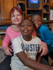 Roberta Milano, seen here in her Aberdeen home with two of the children she cares for, Tyrese Stafford (left), 10 and Emanuel Milano, 7, recently needed help from Press on Your Side in a dispute with Cablevision.