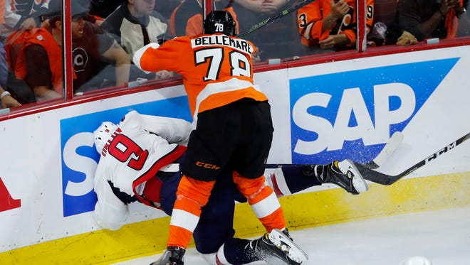Flyers forward Pierre-Edouard Bellemare (78) collides with Capitals' Dmitry Orlov (9) during the third period of Washington's 6-1 Game 3 win on Monday.